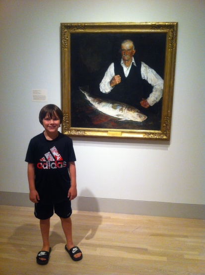 Robert was impressed with this painting of a man with his giant fish.